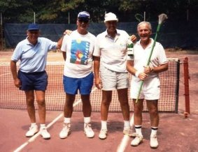 Jim Oliver (second from right) and buddies, circa 1991. Note the champagne bottle!